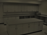 Image of Darkroom cabinets in simulated darkroom lighting conditions