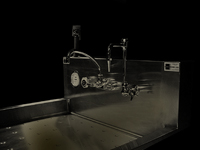 Image of Stainless Steel Tray Sink - Chrome Plated fixture in simulated darkroom lighting conditions.